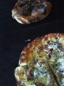 Chanterelle truffle cheese pizza and clam, pancetta and lemon thyme pizza at Serious Pie in Seattle