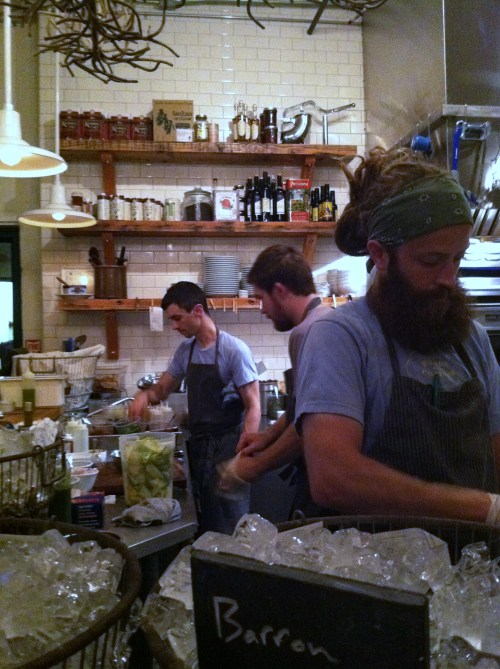 Staff hard at work in the kitchen of the Walrus and the Carpenter in Seattle